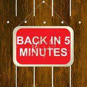 picture of wooden fence  - Back in 5 minutes sign hanging on a wooden fence - JPG