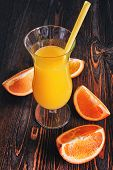stock photo of orange  - orange juice with orange slices on a wooden background - JPG