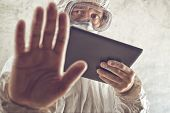 pic of virus  - Chemical Scientist Holding Digital Tablet Computer and Gesturing Stop Sign - JPG
