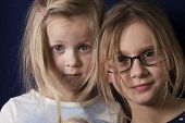 foto of character traits  - Two little girls one surprised another smiling studio portrait - JPG