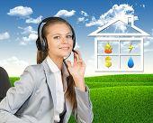 image of public housing  - Businesswoman in headset - JPG