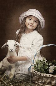 pic of baby goat  - Vintage styled portrait of a little girl with a baby goat - JPG
