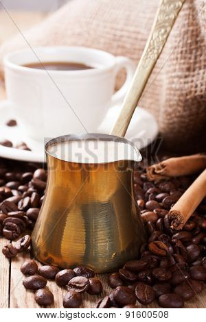 Old coffee pot on wooden rustic background