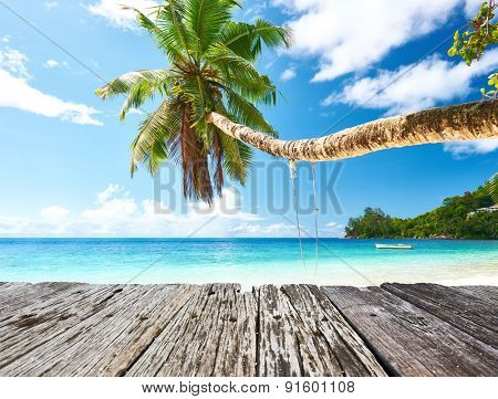 Beautiful beach at Seychelles and old wooden pier