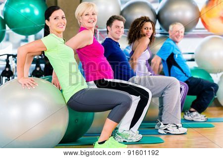 Group of young and senior people exercising in gym, diversity group of and white people