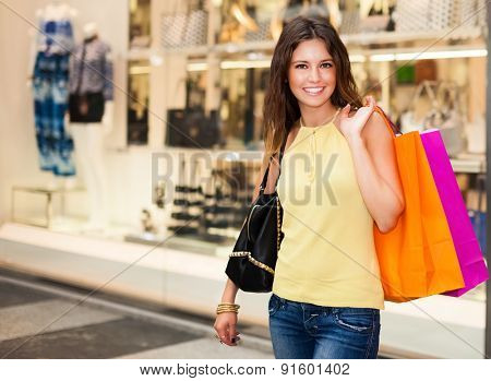 Couple of smiling women doing shopping