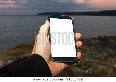 Male Hand Holding Smart Phone On Evening