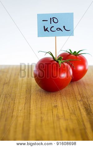 Negative-calories food, tomatoes on a cutting board