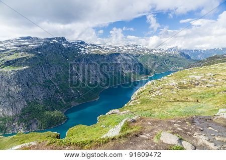 Lake Valley And Mountain Landscape Near Trolltunga, Norway