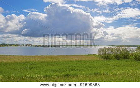 Residential area on the shore of a lake in spring