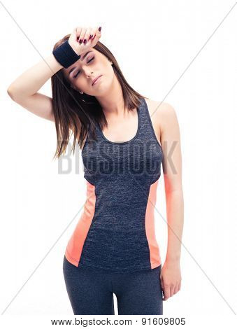 Fitness woman wipes the sweat from his brow isolated on a white background