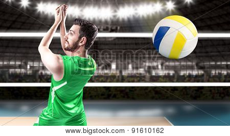 Volleyball player on green uniform on volleyball court