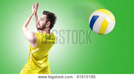 Volleyball player on yellow uniform on green background