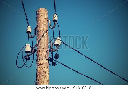 Wooden Column With Electric Wires Of Retro Color