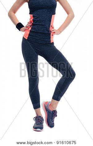 Closeup image of a woman`s fitness body in sports wear. Isolated on a white background