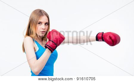 Side view portrait of a young woman in boxing gloves isolated on a white background. Looking at camera