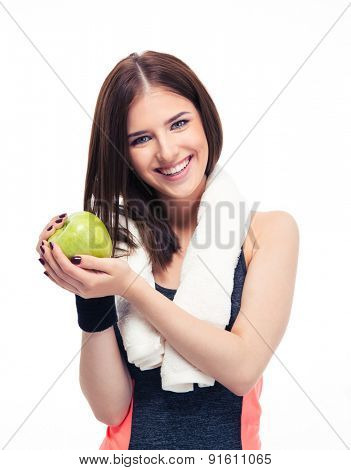 Smiling fitness woman with towel holding green apple isolated on a white background. Looking at camera