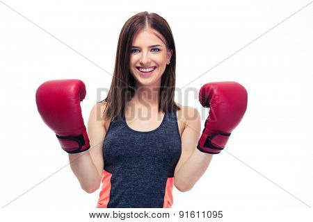 Happy sporty woman in boxing glovesstanding isolaated on a white background. Looking at camera