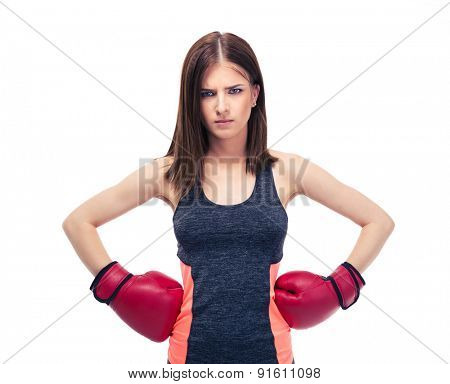 Fitness woman in boxing gloves posing isolated on a white background. Looking at camera