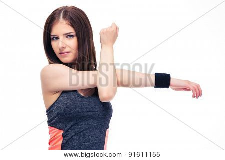 Cute young woman stretching hands and looking at camera. Isolated on a white background