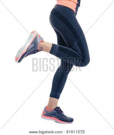 Closeup image of female fitness legs isolated on a white background