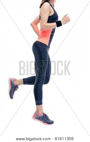 Closeup image of a woman`s fitness body. Running isolated on a white background