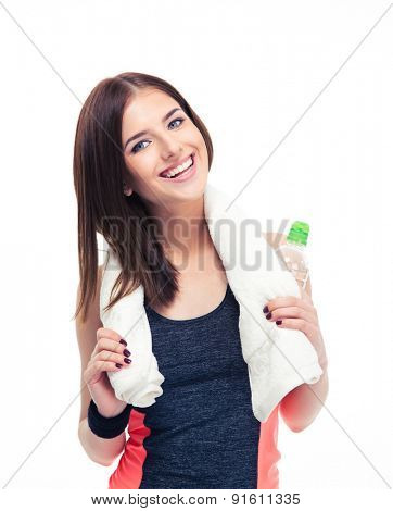 Smiling fitness woman with towel and bottle of water isolated on a white background. Looking at camera