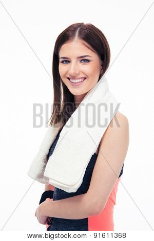 Portrait of a smiling fitness woman with towel isolated on a white background. Looking at camera