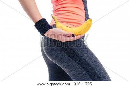 Closeup portrait of a woman`s body with banana isolated on a white background