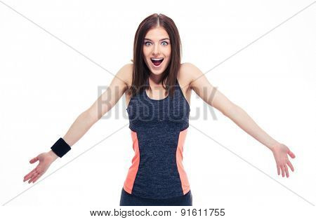 Sporty young surprised woman shrugging her shoulders isolated on a white background. Looking at camera