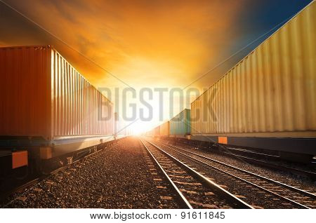 Industry Container Trainst Running On Railways Track Against Beautiful Sun Set Sky Use For Land Tran