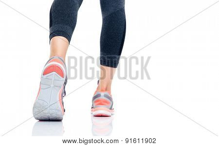 Closeup image of a legs going to run isolated on a white background