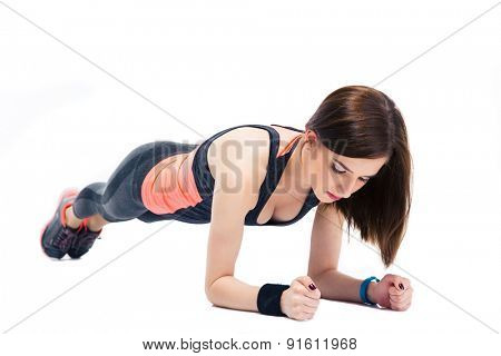 Young cute sporty woman doing exercises on the floor isolated on a white background