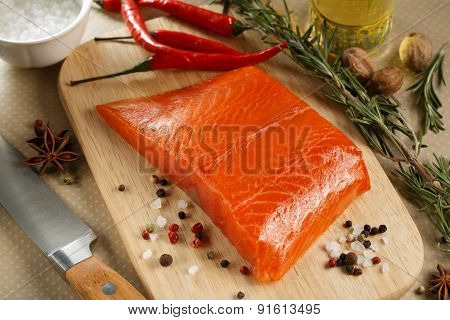 Salmon Steak With Herbs On Cutting Board.