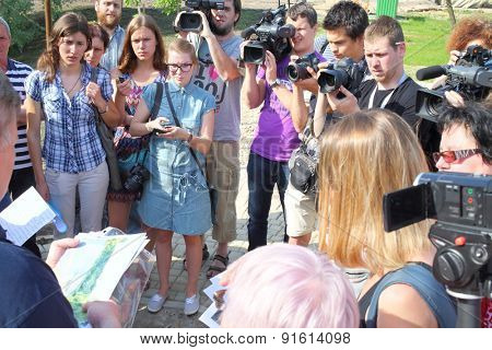 MOSCOW - MAY 19, 2014: The group of reporters about taking interview recreated relaxation area in the national park Losiny Ostrov
