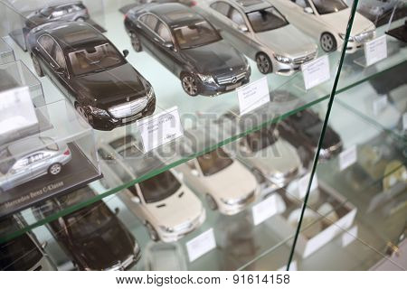 MOSCOW - MAY 14, 2014: Model line Mersedets Benz cars in miniature in dealership Mercedes-Benz Avilon in Moscow