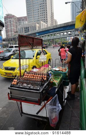 An Unidentified Street Vendor Cooks At A Roadside Restaurant In Bangkok, Thailand.