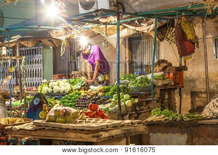 Seller At The Vegetable Night Market