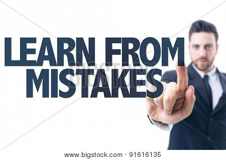 Business man pointing the text: Learn From Mistakes