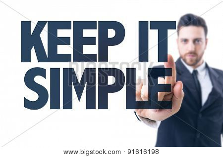 Business man pointing the text: Keep it Simple