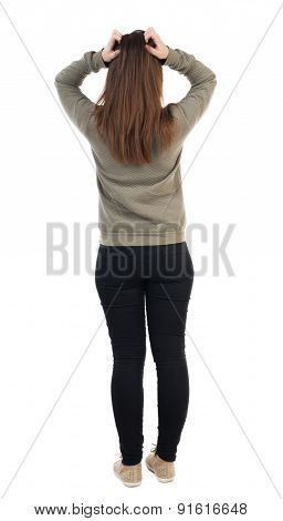 back view of standing young beautiful  woman.  Girl scratching head. Rear view people collection.  backside view of person.  Isolated over white background. woman in panic.