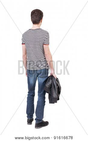Back view man in jeans. Standing young guy. Rear view people collection.  backside view person.  Isolated over white background. The guy in the striped shirt standing and holding a jacket in his hand.