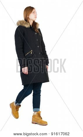 Back view of going  woman in parka. walking young girl. Rear view people collection.  backside view of person.  Isolated over white background. Thoughtful girl passes