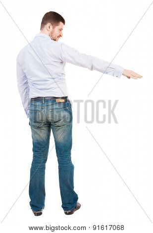 Back view of pointing business man. Rear view people collection.  backside view of person.  Isolated over white background. A bearded man in a shirt shows a hand down
