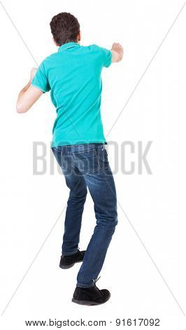 back view of skinny guy funny fights waving his arms and legs. Isolated over white background. Rear view people collection.  backside view of person. Funny guy punches right hand.