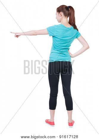 Back view of  pointing woman in sportswear. beautiful girl. Rear view people collection.  backside view of person.  Isolated over white background. Athlete shows left hand