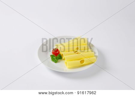 plate of emmental cheese slices with cherry tomato