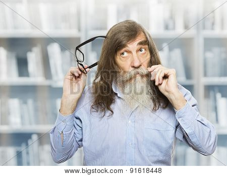 Thoughtful Senior With Glasses Thinking Inspired Looking Up. Pensive Old Man With Beard