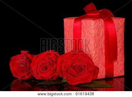 Gift and red roses