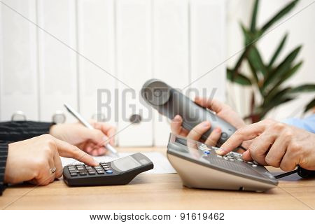 Busy Business People Analyzing Business Data And Calling Customers